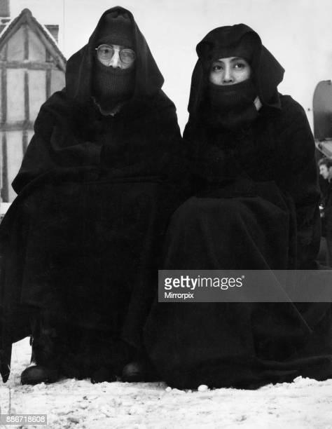 John Lennon of The Beatles pop group pictured with his wife Yoko Ono taking part in another happening In the snow covered village of Lavenham Suffolk...