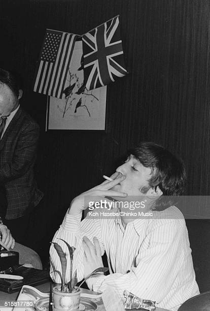 John Lennon of The Beatles smoking a cigarette during an interview at Chicago International Amphitheatre Office August 12 1966