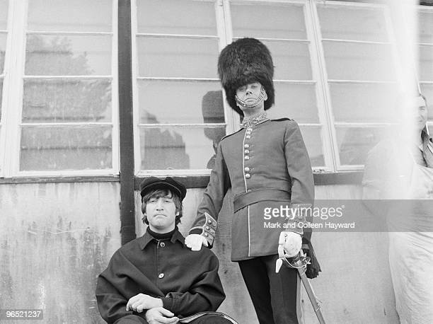 John Lennon of the Beatles with actor Victor Spinetti at Twickenham Studios London during a photoshoot to complete the cover of the Beatles' album...