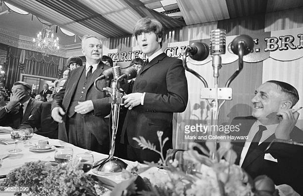 John Lennon of the Beatles with British Labour Leader of the Opposition Harold Wilson at the Variety Club of Great Britain Annual Show Business...
