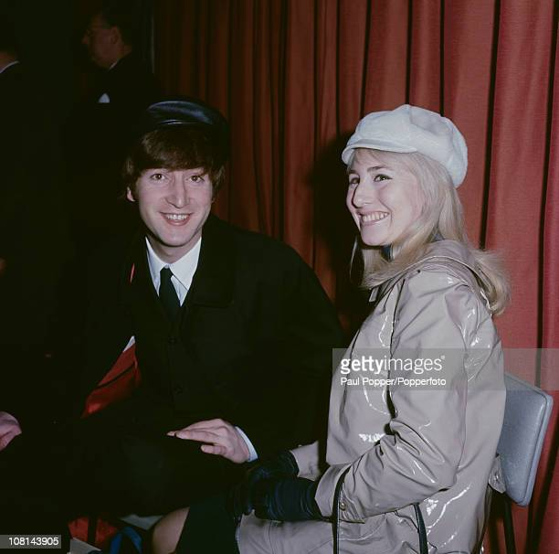 John Lennon of The Beatles with his first wife Cynthia at London Airport before a flight to New York 7th February 1964