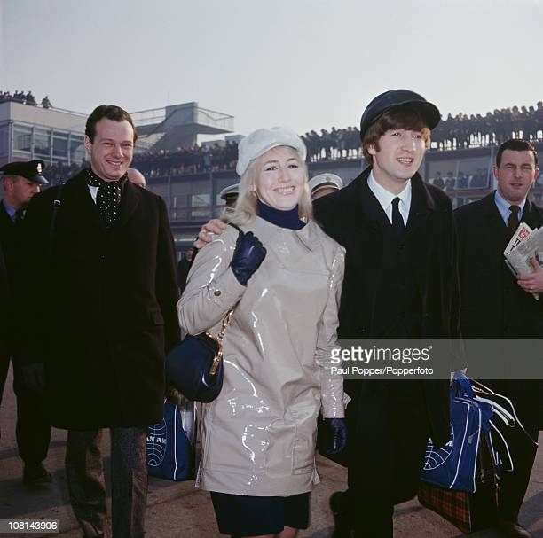 John Lennon of The Beatles with his first wife Cynthia at London Airport before a flight to New York 7th February 1964 On the left is manager Brian...