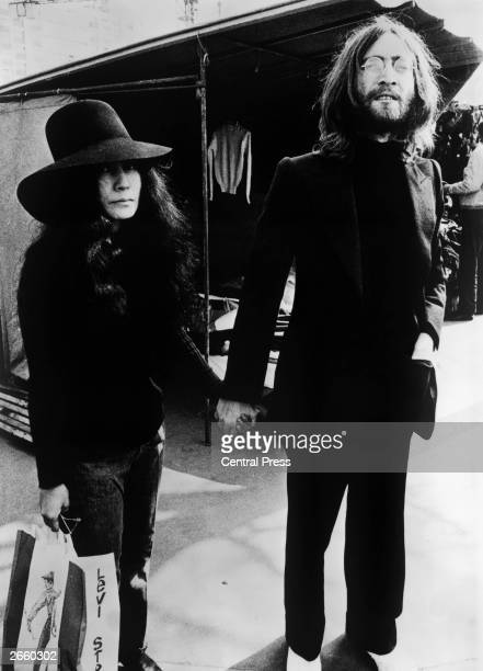 John Lennon of The Beatles with his partner artist Yoko Ono on a visit to Paris following their recent wedding