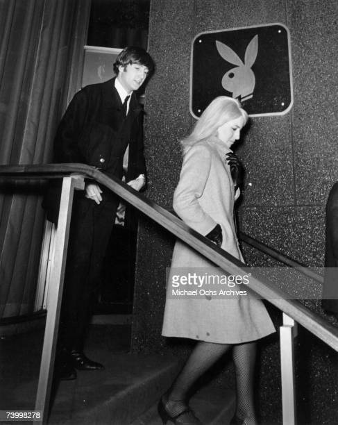 John Lennon of the rock and roll band 'The Beatles' and his wife Cynthia Lennon visit The Playboy Club on February 9 1964 in New York City New York...