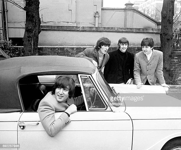 John Lennon passes his driving test in Weybridge Paul McCartney Ringo Starr and George Harrison are there to congratulate him 15 February 1965