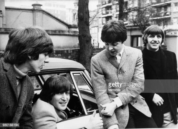 John Lennon passes his driving test in Weybridge Paul McCartney Ringo Starr and George Harrison are there to congratulate him 15th February 1965