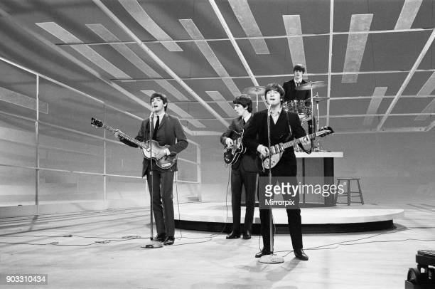 John Lennon Paul McCartney George Harrison and Ringo Starr rehearse their appearance on the Ed Sullivan show. February 1964. .