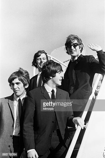 John Lennon Paul McCartney Ringo Starr and George Harrison of The Beatles walking down the steps of the plane as they arrive in San Francisco...