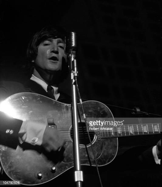 John Lennon performing on stage during the Beatles' first US tour 1964