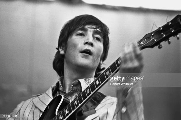 John Lennon performing with the Beatles at the Rizal Memorial Football Stadium Manila Philippines during the group's final world tour 4th July 1966