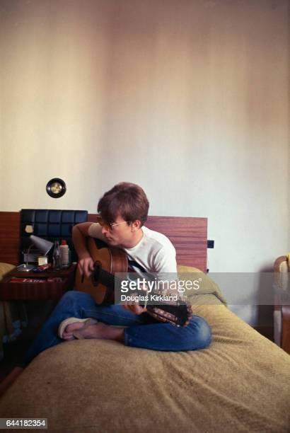 John Lennon Playing Guitar in Hotel Room