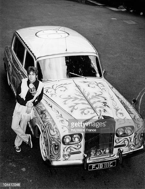 John LENNON posing in front of his psychedelic ROLLS ROYCE in his property of Weygridge Surrey