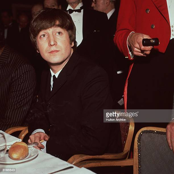 John Lennon singer songwriter and guitarist with The Beatles pictured at Foyle's Literary Luncheon in London