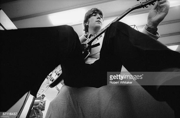 John Lennon tunes his guitar in his dressing room at the Nippon Budokan in Tokyo during the Beatles' Asian tour 2nd July 1966