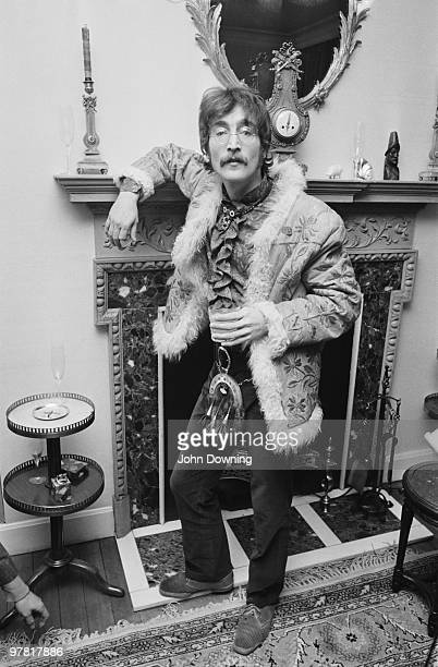 John Lennon wearing an afghan coat and a sporran at the press launch for the Beatles' new album 'Sergeant Pepper's Lonely Hearts Club Band' held at...