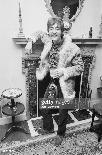 John Lennon wearing an afghan coat and a sporran at the press launch for the Beatles' new album 'Sergeant Pepper's Lonely Hearts Club Band', held at...