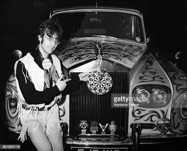John Lennon with a psychedelic Rolls Royce in the United Kingdom circa 1960