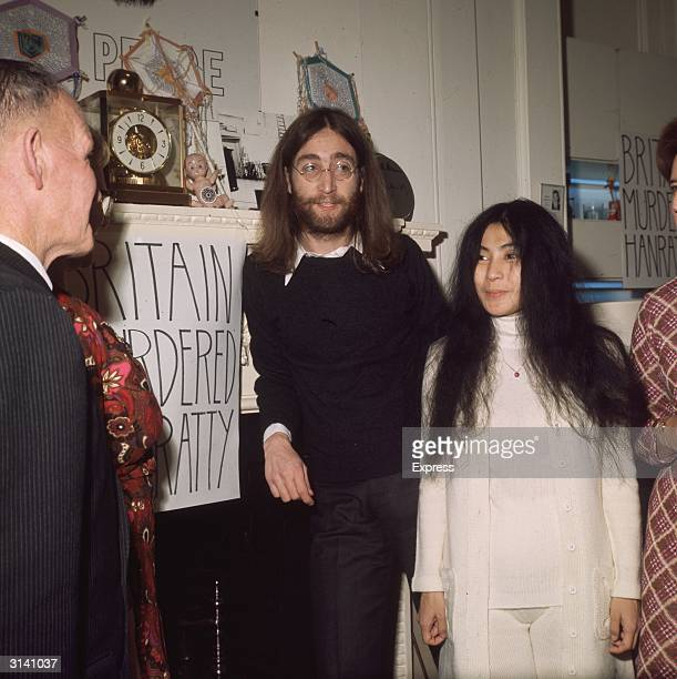 John Lennon with his wife Yoko Ono and James Hanratty Senior at a protest meeting against the controversial execution of Hanratty's son for the A6...