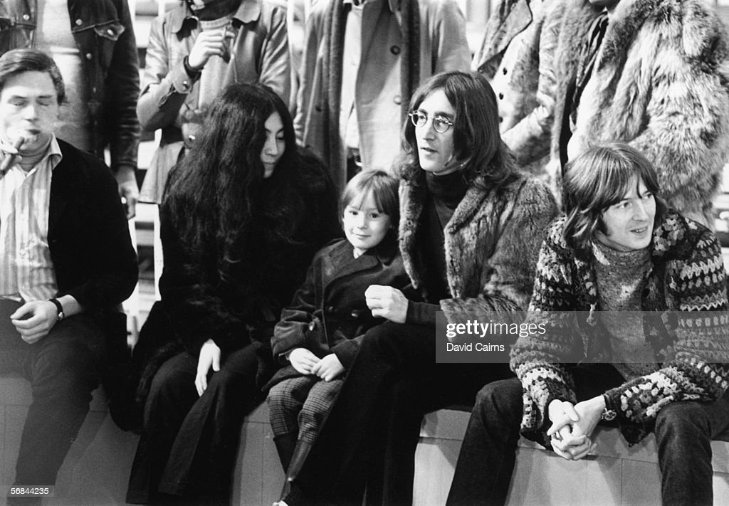 John Lennon (1940 - 1980) with Yoko Ono, his son Julian and guitarist Eric Clapton during a rehearsal for the Rolling Stones' 'Rock and Roll Circus' TV special, at Internel Studios in Stonebridge Park, Wembley, London, 10th December 1968.