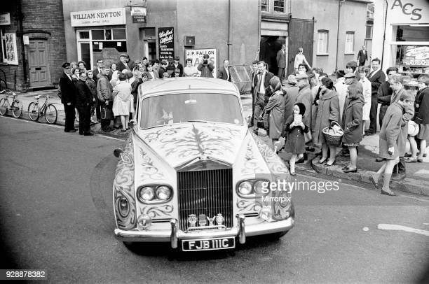 John Lennon's refurbished Rolls a ø6000 1965 Phantom V is now a shrieking yellow with zodiac sig on the roof and scrolls and flowers in a...