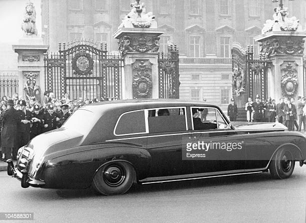 John Lennon's Rolls Royce approaches the gates of Buckingham Palace London England on October 261965