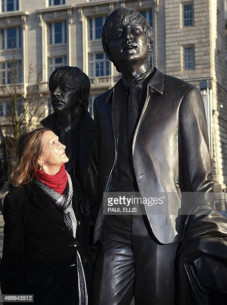 John Lennon's sister Julia Baird looks up at a statue of her late brother part of a new statue of British band The Beatles created by sculptor Andy...