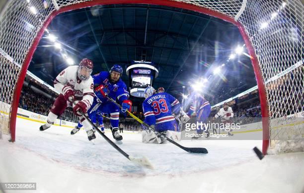 John Leonard of the Massachusetts Minutemen scores a goal against Tyler Wall of the Massachusetts Lowell River Hawks during NCAA men's hockey at the...