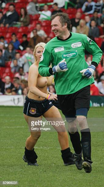 John Leslie is chased by a streaker as he takes part in the London edition of the annual fundraising tournament Music Industry Soccer Six at West...