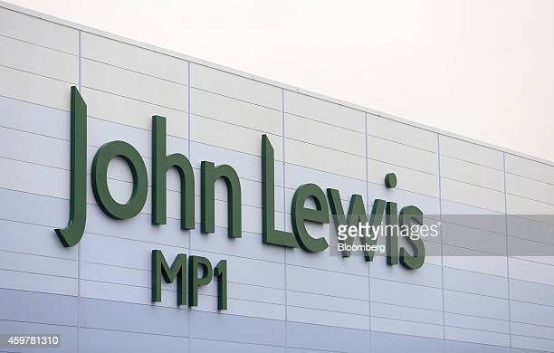 A John Lewis logo sits outside the John Lewis Plc semiautomated distribution centre in Milton Keynes UK on Monday Dec 1 2014 The pound rallied from...