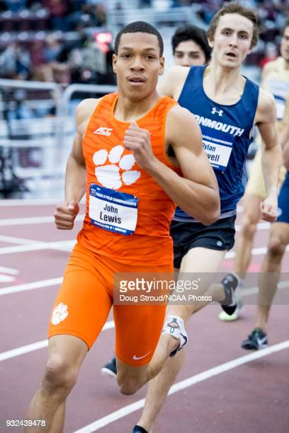 John Lewis of Clemson University leads with Dylan Capwell of Monmouth University following in the Mens 800 Meter Run during the Division I Men's and...