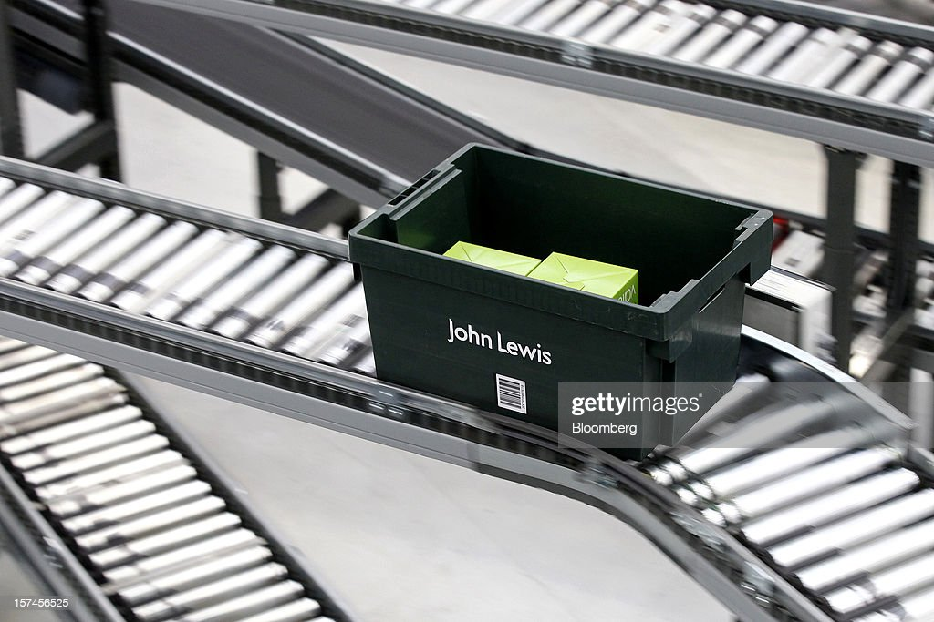 A John Lewis Plc-branded crate carries a customer's order as it travels along a Knapp AG warehouse logistics system at the company's semi-automated distribution centre in Milton Keynes, U.K., on Monday, Dec. 3, 2012. An index of U.K. retail sales rose to a five-month high in November, according to a monthly report from the Confederation of British Industry. Photographer: Simon Dawson/Bloomberg via Getty Images