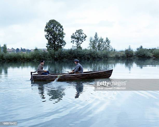 John Leyton as Willie Dickes and Charles Bronson as Danny Velinski make their escape in a rowing boat in 'The Great Escape' directed by John Sturges...
