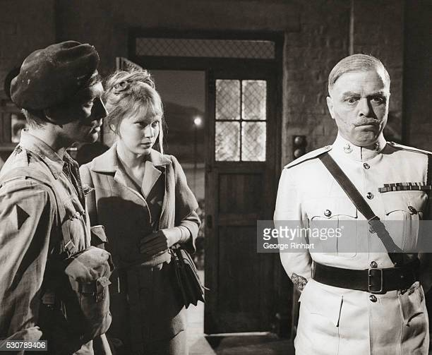 John Leyton Mia Farrow and Richard Attenborough starring in Guns at Batasi This 1964 film was directed by John Guillermin