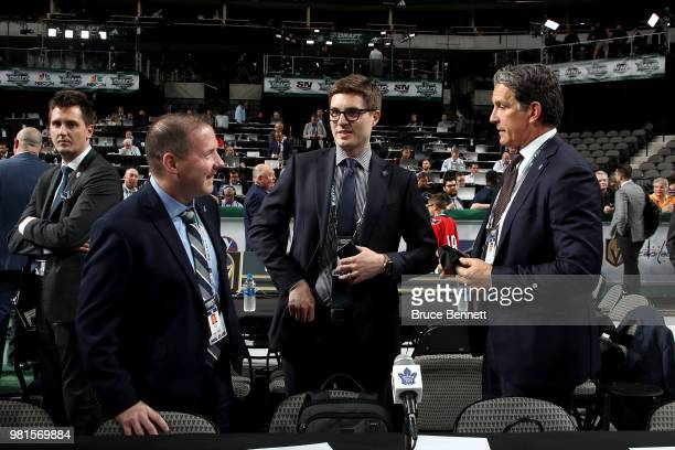 John Lilley, Kyle Dubas and Brendan Shanahan of the Toronto Maple Leafs talk prior to the first round of the 2018 NHL Draft at American Airlines...