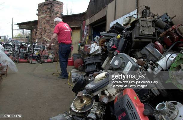 John Lindsey a mechanic for AAA Lawnmower cleans a carburetor for a lawnmower outside of the shop on Wednesday