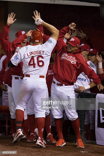 John Lindsey celebrates with teammates after scoring during a match between Pericos de Puebla and Diablos Rojos as part of Serie del Rey Mexican...