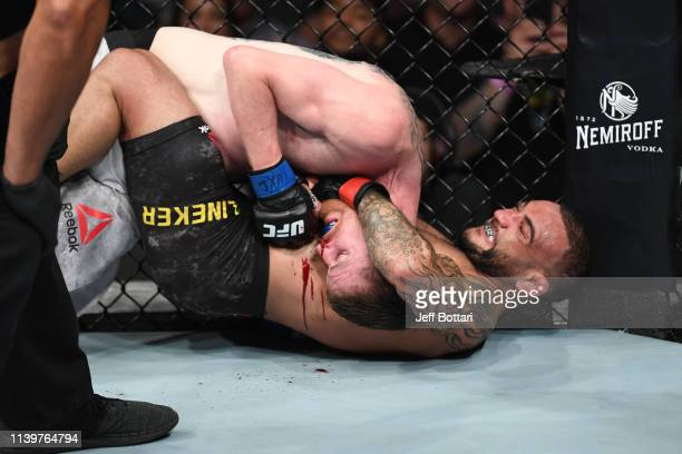 John Lineker of Brazil attempts to submit Cory Sandhagen in their bantamweight bout during the UFC Fight Night event at BBT Center on April 27 2019...