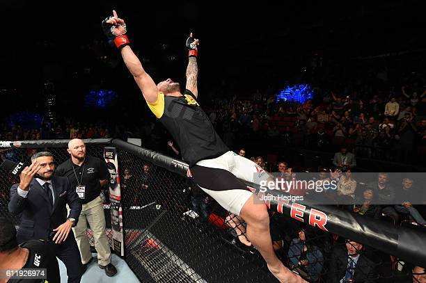 John Lineker of Brazil celebrates after defeating John Dodson by split decision in their bantamweight bout during the UFC Fight Night event at the...