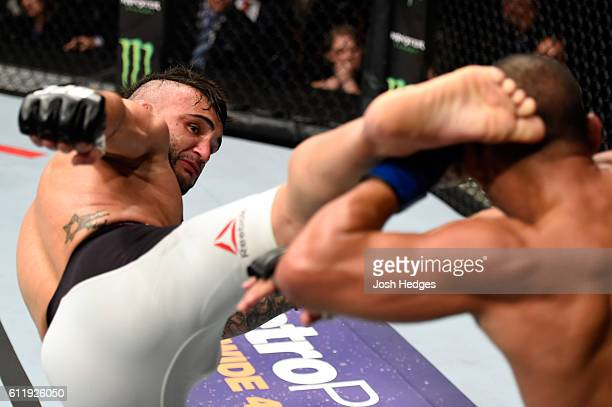 John Lineker of Brazil kicks John Dodson in their bantamweight bout during the UFC Fight Night event at the Moda Center on October 1 2016 in Portland...