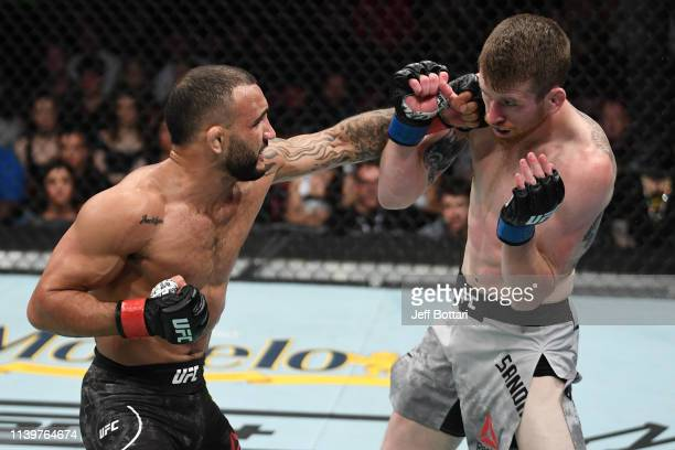 John Lineker of Brazil punches Cory Sandhagen in their bantamweight bout during the UFC Fight Night event at BBT Center on April 27 2019 in Sunrise...
