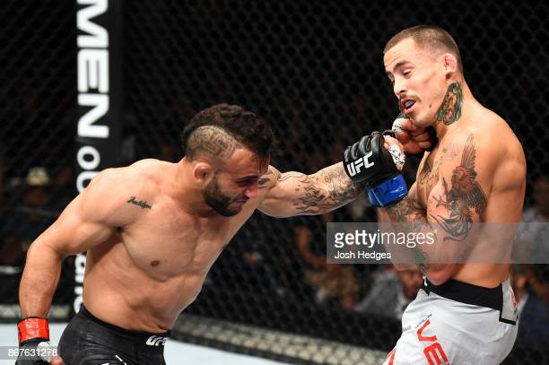 John Lineker of Brazil punches Marlon Vera of Ecuador in their bantamweight bout during the UFC Fight Night event inside the Ibirapuera Gymnasium on...