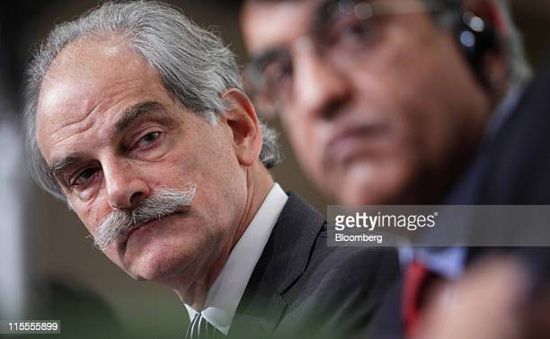 John Lipsky acting managing director of the International Monetary Fund listens during a news conference in Tokyo Japan on Wednesday June 8 2011 The...