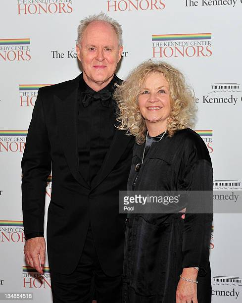 John Lithgow and his wife Dr Mary Yeager Lithgow arrive for the formal Artist's Dinner honoring the recipients of the 2011 Kennedy Center Honors...