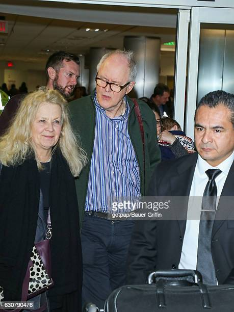 John Lithgow and Mary Yeager are seen at Los Angeles International Airport on January 01 2017 in Los Angeles California