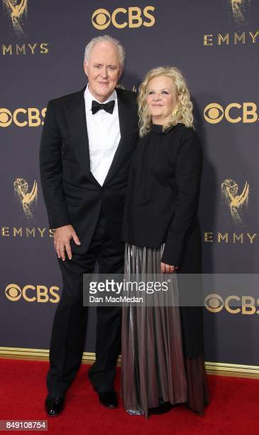 John Lithgow and Mary Yeager arrive at the 69th Annual Primetime Emmy Awards at Microsoft Theater on September 17 2017 in Los Angeles California
