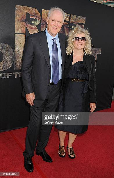 John Lithgow and Mary Yeager arrive at the Rise Of The Planet Of The Apes Los Angeles Premiere at Grauman's Chinese Theatre on July 28 2011 in...