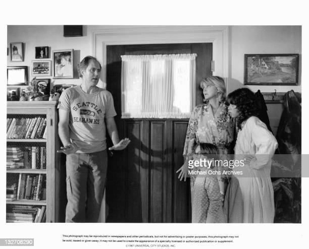 John Lithgow tells Melinda Dillon Joshua Rudoy Margaret Langrick to keep cool and hide Harry from their neighbor in a scene from the film 'Harry And...