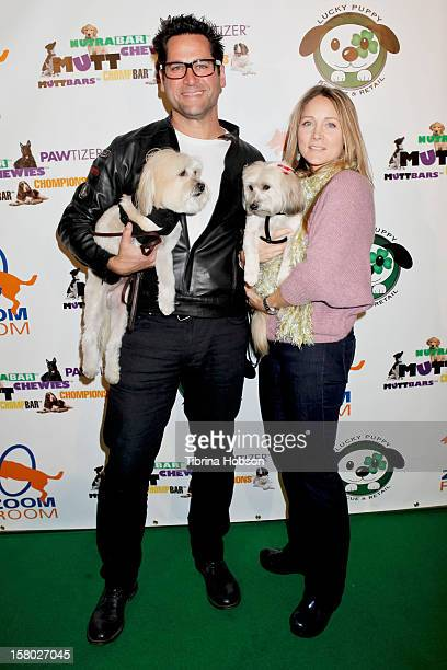 John Littlefield and Nadine Stenovitch attends the Lucky Puppy Rescue and Retail grand opening on December 8 2012 at Lucky Puppy Rescue in Studio...