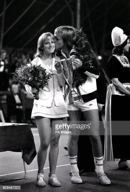 John Lloyd kisses his American wife Chris Evert after defeating Swedish tennis ace Bjorn Borg and his fiancee Mariana Simionescu
