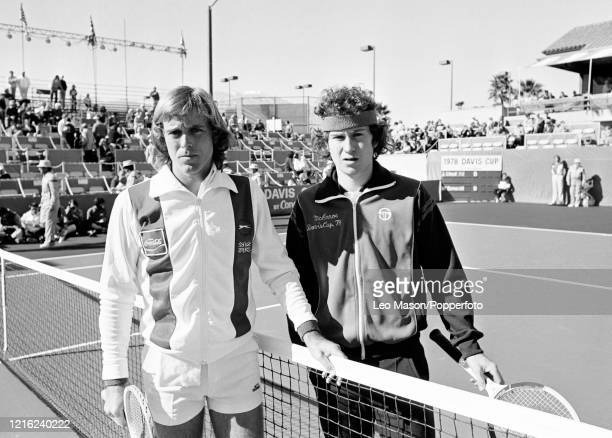 John Lloyd of Great Britain and John McEnroe of the United States pose before their match during the 1978 Davis Cup Final at the Mission Hills...